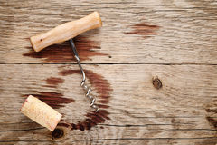 Corkscrew, cork and wine stains Royalty Free Stock Images