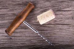 Corkscrew, cork and wine stains Stock Photography