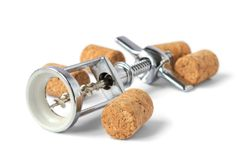 Corkscrew with corks. A closeup, detailed view of a corkscrew with corks from wine bottles Stock Image