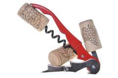 Corkscrew with corks Royalty Free Stock Photos