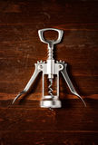 Corkscrew  on dark wooden table. Top view Stock Image