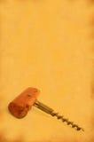 Corkscrew do vintage de encontro ao papel velho manchado #2 fotografia de stock