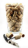 Corkscrew and glass vase with corks Stock Photos