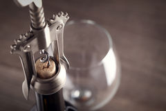 Corkscrew and a glass of wine Royalty Free Stock Images