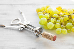 Corkscrew, grape and wine cork Royalty Free Stock Photography