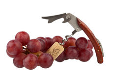 Corkscrew and grapes Royalty Free Stock Images
