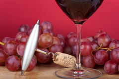 Corkscrew and grapes Royalty Free Stock Photos