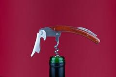 Corkscrew no fundo vermelho Fotografia de Stock Royalty Free