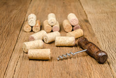 corkscrew for open wine bottle on wooden background Royalty Free Stock Photos