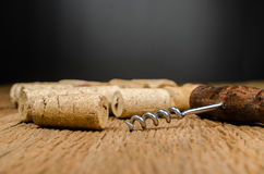 corkscrew for open wine bottle on wooden background Royalty Free Stock Photography