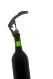 A corkscrew in opening a bottle of wine Royalty Free Stock Images