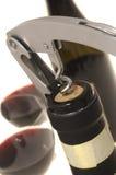Corkscrew opening wine bottle Royalty Free Stock Images