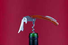 Corkscrew on red background Royalty Free Stock Photography