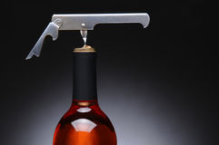 Corkscrew in Red Wine Bottle Stock Photos