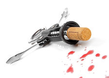Corkscrew and red wine drops Stock Images
