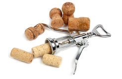 Corkscrew and stoppers. Metal corkscrew and some stoppers from bottles Stock Photography
