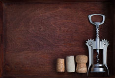 Corkscrew and three wine corks into dark box. Corkscrew and three different wine corks into dark box Stock Image