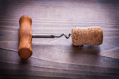 Corkscrew twisted in cork of champagne on vinatge Royalty Free Stock Image