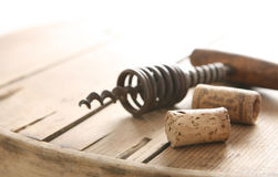 Corkscrew and two corks Stock Image
