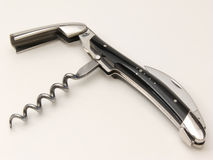 Corkscrew, Waiter's Knife. Corkscrew with black horn handle with a small cross of nails. isolated on white, closeup stock photo