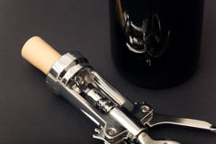 Corkscrew and wine bottle Royalty Free Stock Photos
