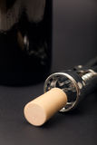 Corkscrew and wine bottle Stock Images