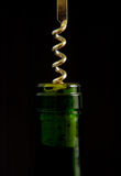 Corkscrew in wine bottle top. Cork screwed into bottle top Stock Photos