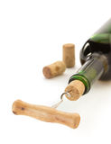 Corkscrew and wine bottle on white Royalty Free Stock Photography