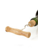 Corkscrew and wine bottle on white Stock Image