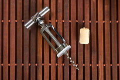 Corkscrew and wine cork Stock Photos