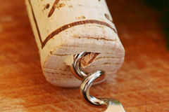 Corkscrew with wine cork, macro Royalty Free Stock Image