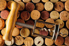 Corkscrew and wine corks Stock Photo