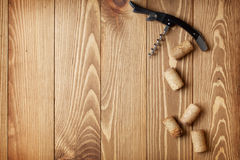 Corkscrew and wine corks Stock Image