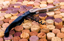 Corkscrew on wine stoppers Royalty Free Stock Images