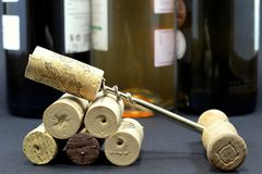 Corkscrew, wines and corks. Corkscrew, wines bottles and the corks Stock Photo