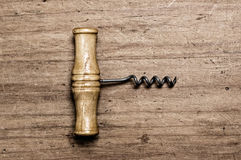 Corkscrew on wood. Royalty Free Stock Image