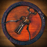 Corkscrew and Wooden Barrel Stock Image