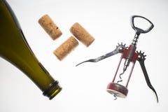 Corkscrews white background wine bottle Royalty Free Stock Photos