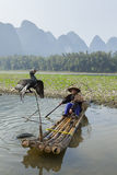 Cormorant, fish man and Li River scenery sight with fog in sprin Stock Photo