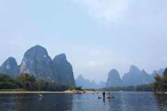 Cormorant, fish man and Li River scenery sight with fog in sprin Royalty Free Stock Photos