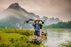 Cormorant Fisherman. And his birds on the Li River in Yangshuo, Guangxi, China Stock Photography