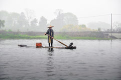 Cormorant and fisherman Stock Photos