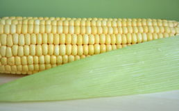 Corn. And its leave on a brown desk Royalty Free Stock Photography