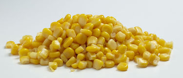 Corn. Grain with white background Stock Photos
