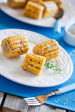 Corn. Grilled corn with butter, garlic and thyme, selective focus Royalty Free Stock Photography