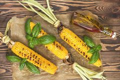Corn baked in olive oil, with salt and basil on parchment paper Stock Photography