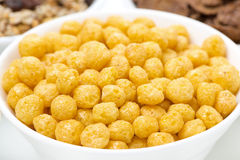 Corn balls and breakfast cereals, close-up Stock Photos