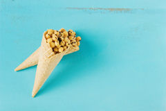 Corn balls in waffle cones Royalty Free Stock Images