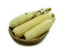 Corn White. Corn In the basket isolated on white background Stock Photo