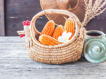 Corn in basket, on wooden table Royalty Free Stock Photo